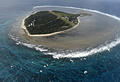 """** FILE**  A Friday, May 10, 2013 file photo shows an aerial view of Lady Elliott Island. The 45 hectares island is the southernmost coral cay of the Great Barrier Reef.  Australia's Great Barrier Reef will not be listed as endangered but will remain under watch because of """"major threats"""" to its health, a draft recommendation released Friday, May, 29, 2015 by UNESCO to the UN's World Heritage Committee. (AAP Image/Dan Peled) NO ARCHIVING"""